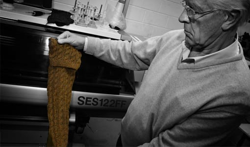 House of Cheviot technology director Robin Deas individually checking each pair of socks