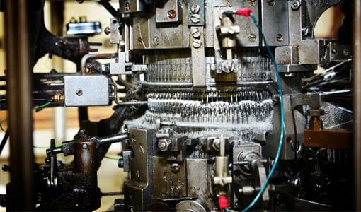 Mechanised sock making equipment