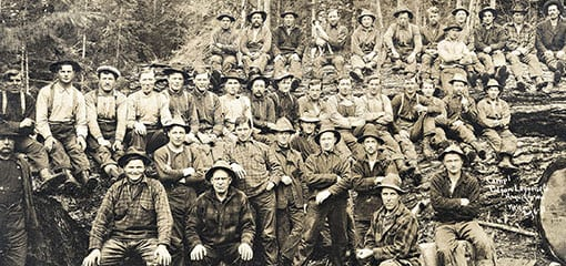 Workers in Seattle during the gold rush wearing Filson workwear clothing