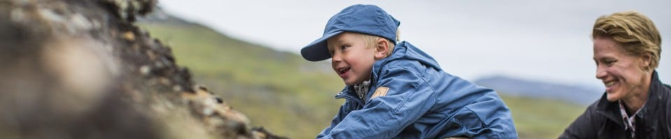 Kid Wearing Premium Outdoor Clothing, Cap and Jacket