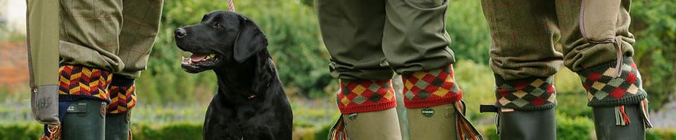 Country Folks Wearing Colourful Shooting Socks & Garters With Working Dog