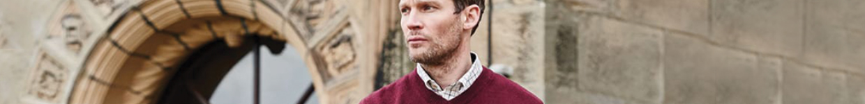 Mens Red Knitwear Jumper Against Gothic Backdrop