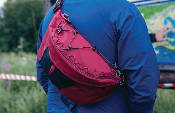 Walker Wearing Klattermussen Jacket and Bag