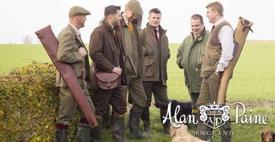 Group of Hunters with Shotguns and Dogs Wearing Alan Paine Jackets, Caps Country Attire