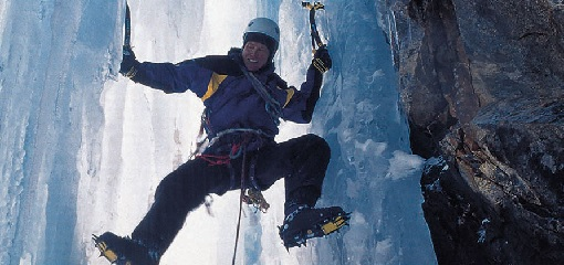 Alan Hinkes Climbing Ice Sheet Using Ice Axes and Boots with Crampons