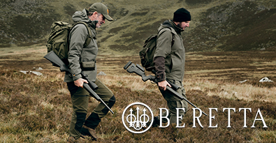 Two Hunters With Rifles Wearing Beretta Clothing & Backpacks