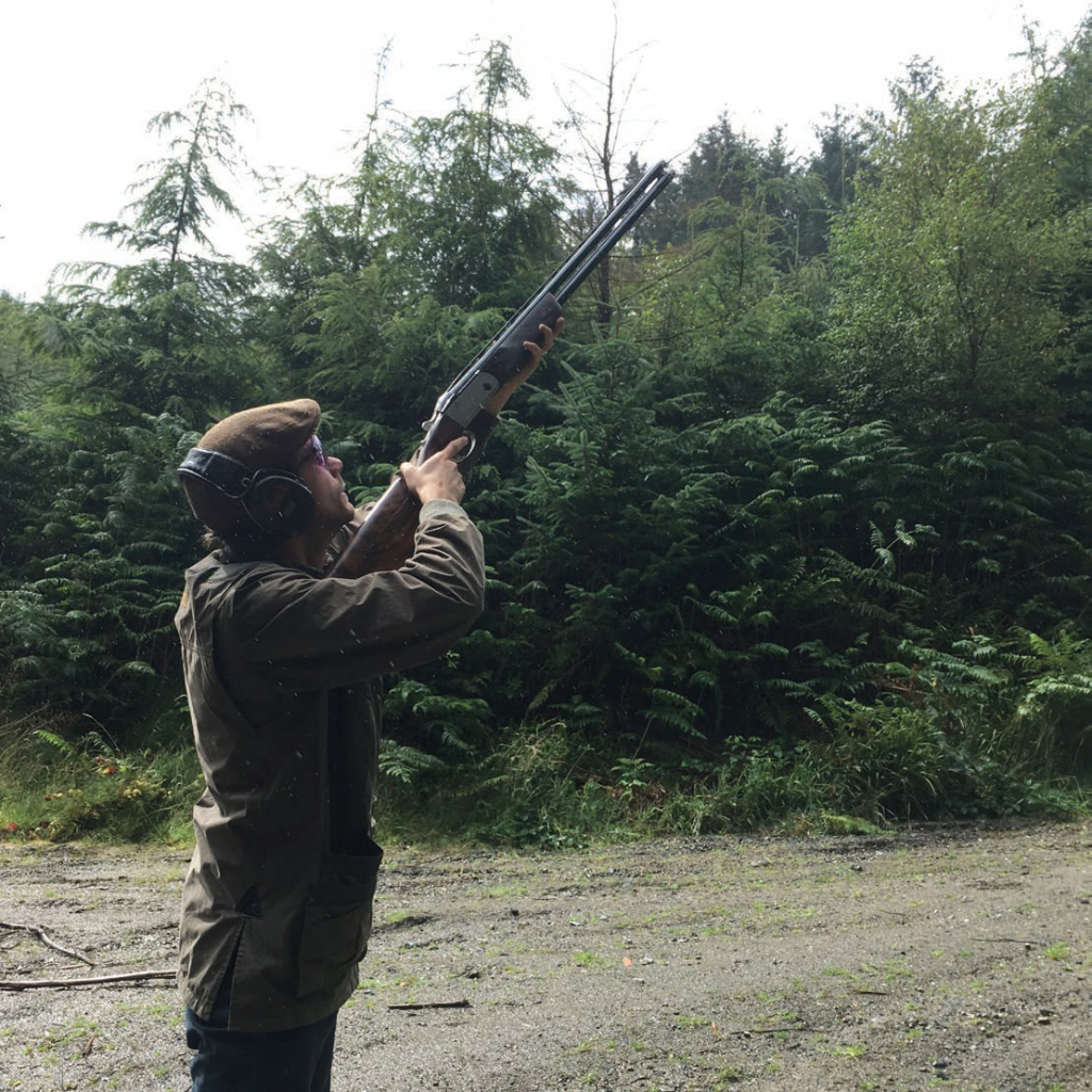 Brett Davies With Shotgun Shooting Wearing Ear Protection