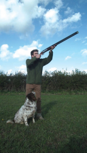 Brett Davies Shooting With Hunting Dog