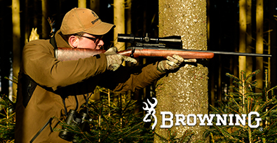 Hunter Aiming Rifle Wearing Brown Shooting Jacket and Cap