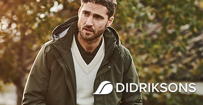 Man Wearing a Didriksons Green Hooded Jacket