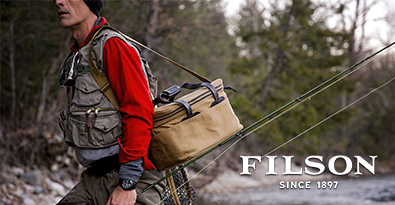 Extreme Fishing Wearing Filson Outdoor Shirt and Vest and Large Fishing Bag
