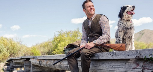Hunter on Bridge Beretta Attire With Gun Dog