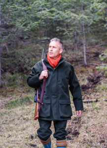 Hunter in Woodland With Beretta Gun and Jacket