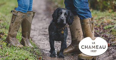 Dog Spaniel on Muddy Track with Walkers Wearing Le Chameau Vierzonord Prestige Wellington Boots Sporting Lodge