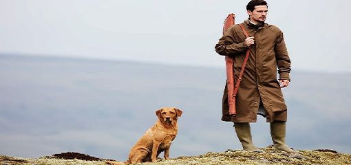 Man With Shotgun and Hunting Dog Wearing Purdey Full Length Overcoat