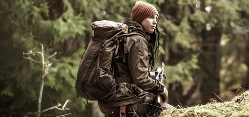 Woman Hunter in Woodland with Fjallraven Backpack and Shotgun