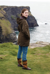 Women Wearing the Latest Dubarry Jacket and Boots by the Coast