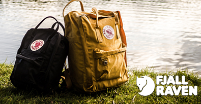 Fjallraven Kanken Backpack and Kanken Classic Bag on Grass Bank next to lake