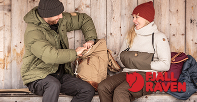 Couple in Log Cabin Wearing Fjallraven Numbers Clothing