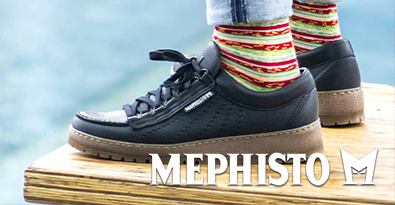 Wearing Mephisto Rainbow leather shoe standing on wooden chair