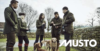 Country Folk Wearing Musto Dark Moss Coloured Highland GORE-TEX Lite Jackets with Working Dogs