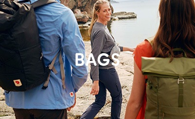 Group of Women Walking along the coast carrying Fjallraven Backpacks.