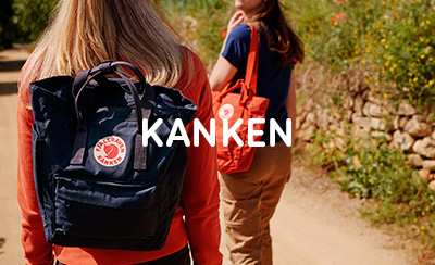 Two Women Walking in Coutryside with Blue and Orange Kanken TotePack Bags