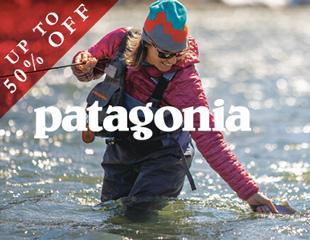 Woman fishing in waders wearing Patagonia