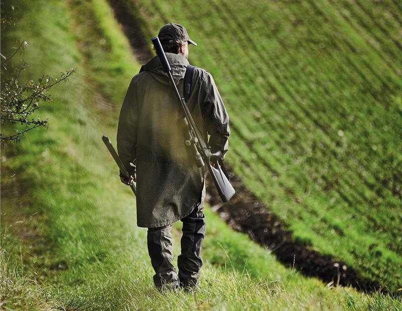 Country Gentleman Wearing Blaser Attire With Rifle