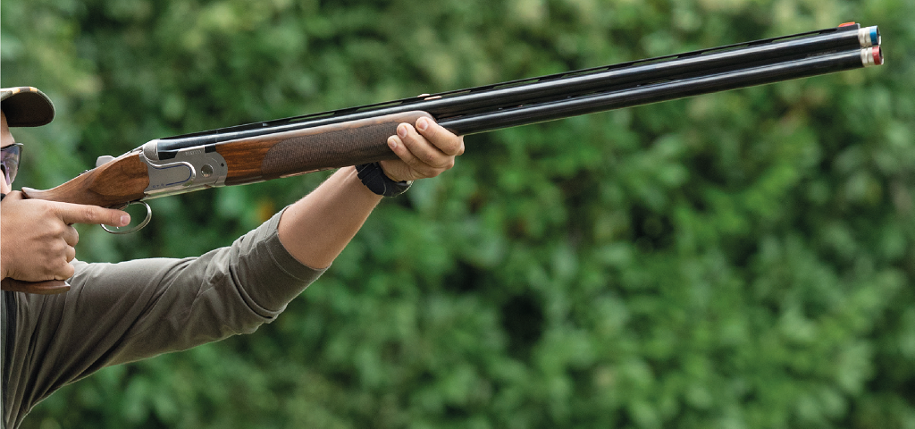 Clay Shooter James Bradley-Day Aiming Shotgun