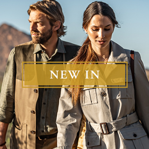 New In Clothing: Man and Woman Wearing Designer Shirts, Jacket and Hat