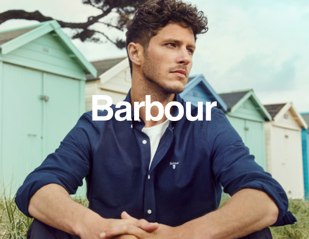 Man wearing Barbour shirt and white t-shirt on the seaside