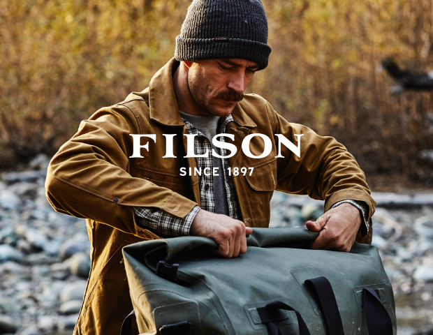 Man Wearing Filson Beige Shirt with Bag and Hat
