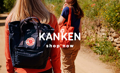 Two Women Walking in Coutryside with Blue and Orange Kanken TotePack Bags.