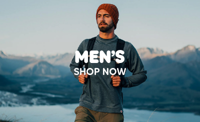 Man Hiking in Mountain Range Wearing Fjallraven Blue T-Shirt, Red Beanie Hat and Backpack.