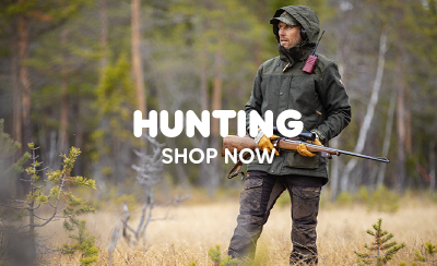 Man Hunting in Forest Carrying Rifle, Wearing Fjallraven Greenland Hooded Jacket and Greenland Jeans Regular.