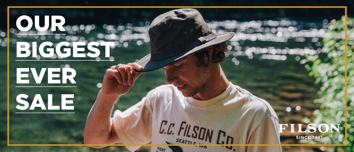 Man Wearing Filson Tin Packer Hat and T-Shirt