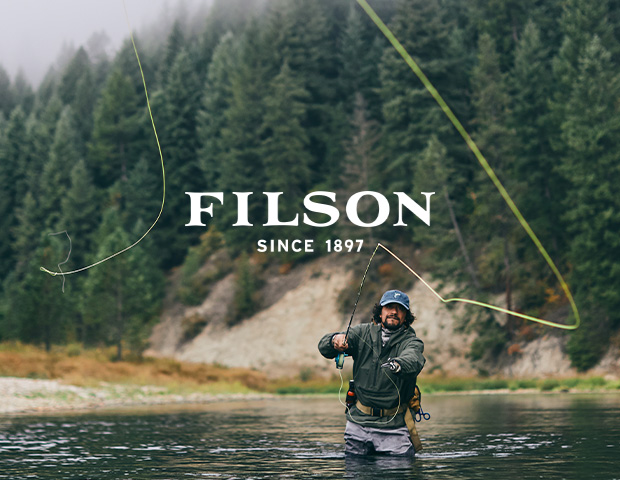 Man Fishing in Filson Cap and T-Shirt
