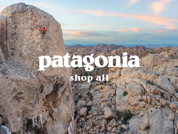Climber ascending mountain peak in rocky landscape wearing Patagonia Climbing Gear