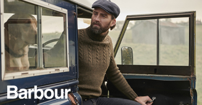 Country Gent Barbour Sweater and Cap Exiting Land Rover