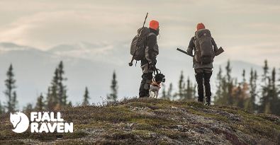 Two hunters wearing full Fjallraven hunting gear jackets, trousers & backpacks