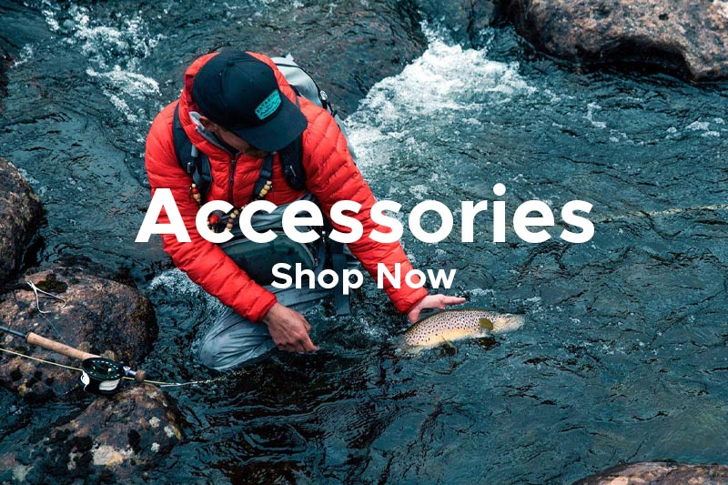 Man Wearing Patagonia Cap and Accessories Catching Fish in Fast Flowing Stream
