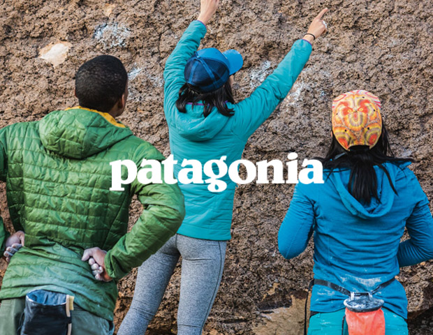 Man and women wearing Patagonia jackets and caps