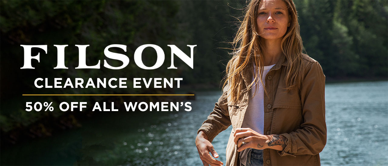 Woman wearing Filson Rugged Jacket in Tan with White T-Shirt