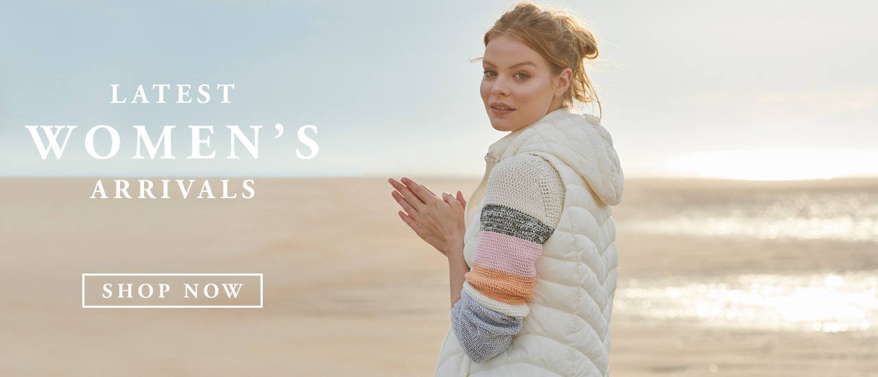 Woman wearing Barbour Autumn/Winter White Down Hooded Sweater Vest  on Beach