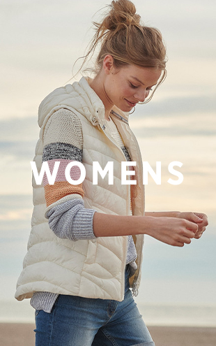 Woman Wearing Barbour Gilet and Knitted Jumper