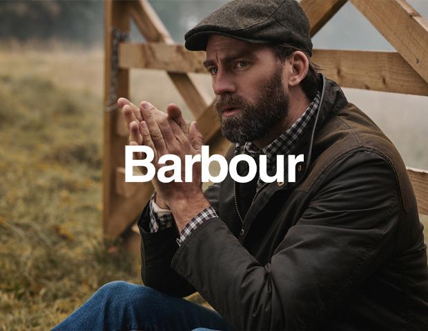 Man wearing Barbour Flat Cap and Coat