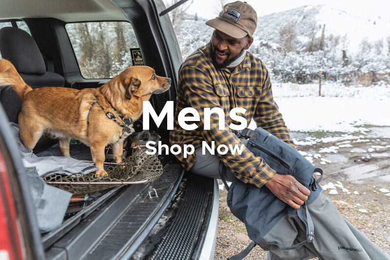 Man sat on 4 Wheel Drive Vehicle with Hunting Dog putting on Waterproof Patagonia Waders.