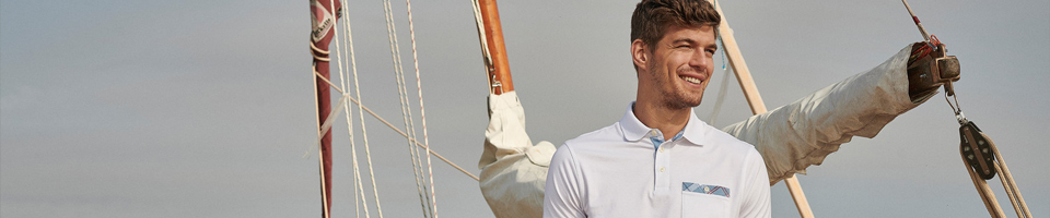 Man Wearing Classic Design White Polo Shirt, Standing on Yacht