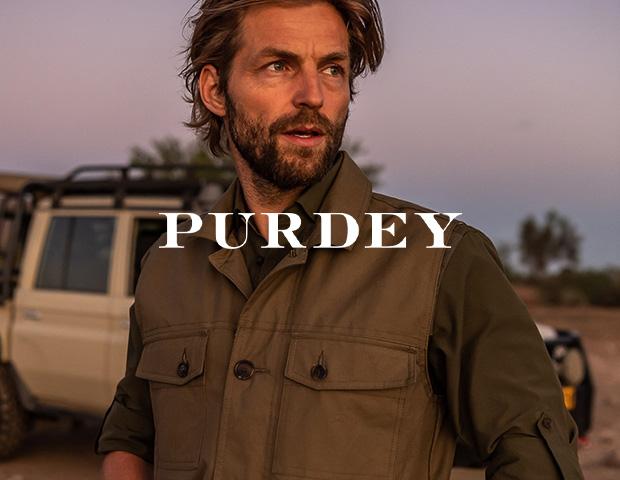 Man wearing James Purdey Safari Gilet Vest and Safari Shirt in Olive